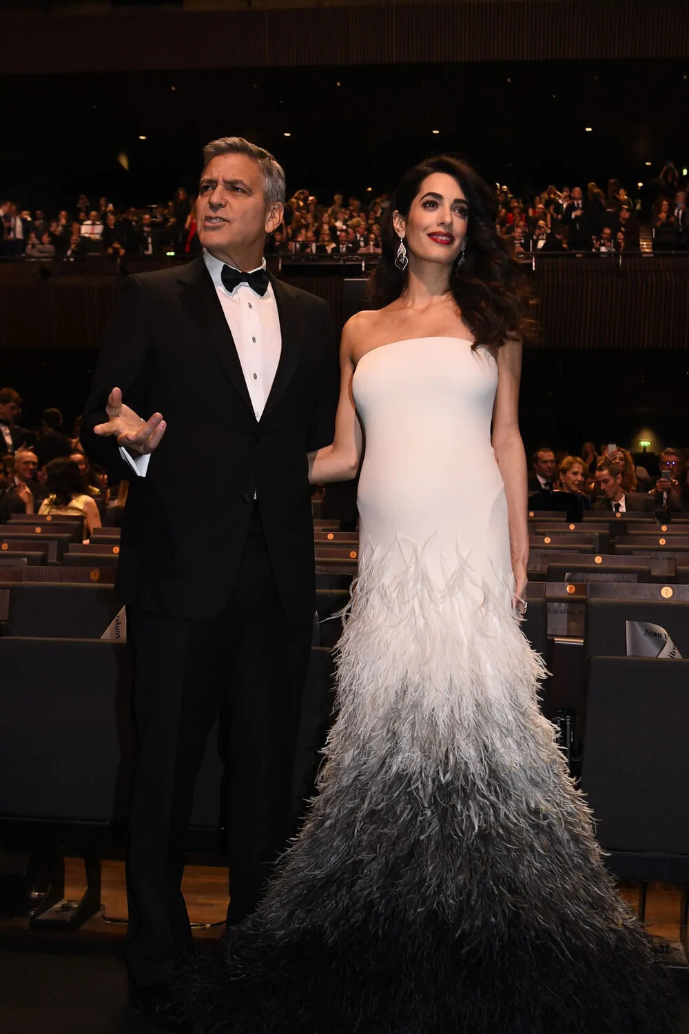 George Clooney and his wife British-Lebanese lawyer Amal Clooney pose as they arrive for the 42nd edition of the Cesar Ceremony. (Credit: AFP/Getty Images)