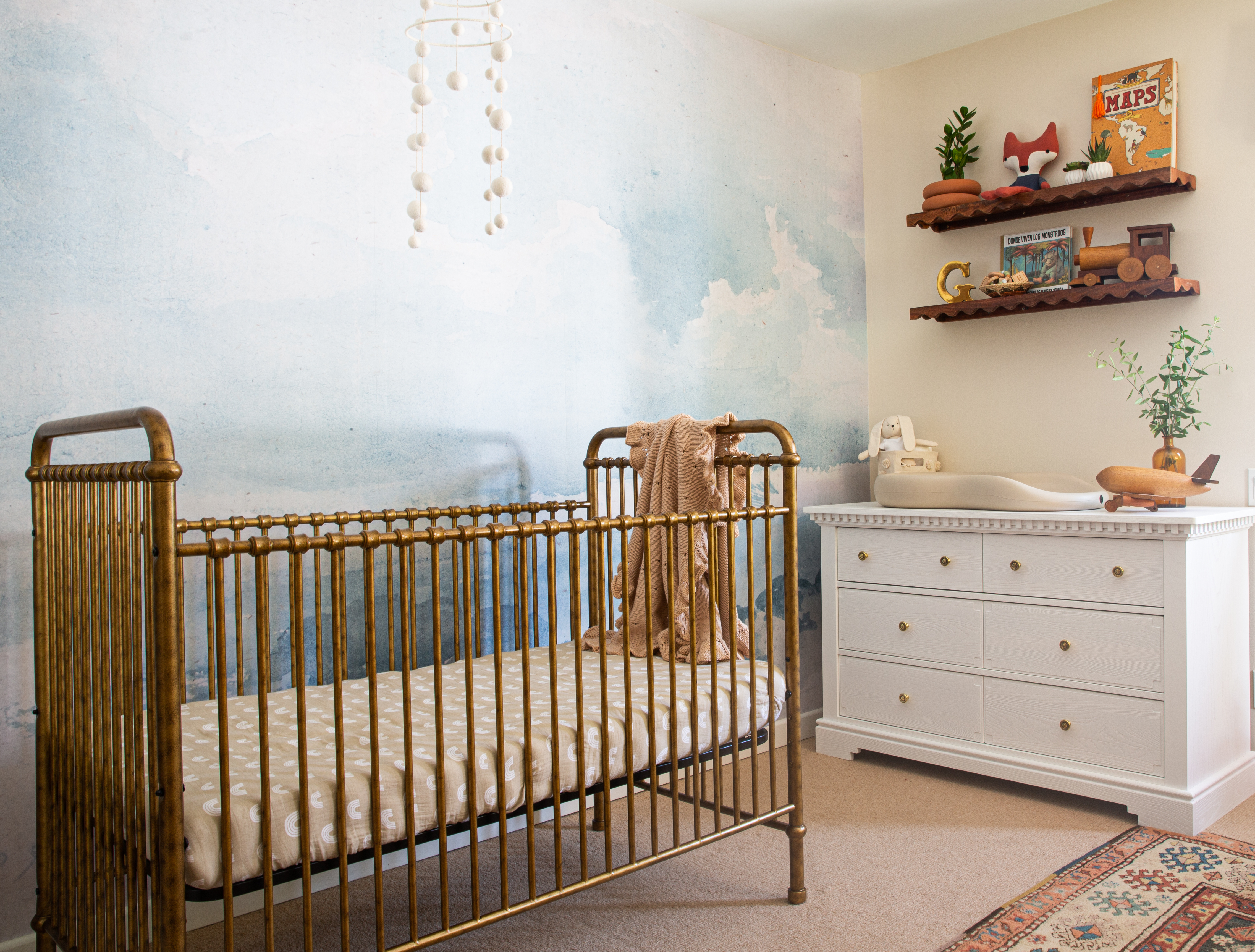 I swapped out the dresser pulls with antique brass knobs that would tie in with the gold crib in the nursery.